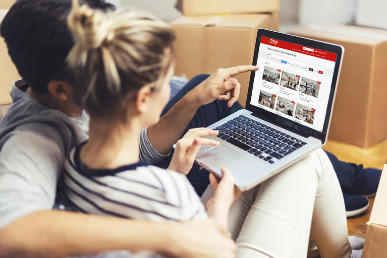 couple looking online homes