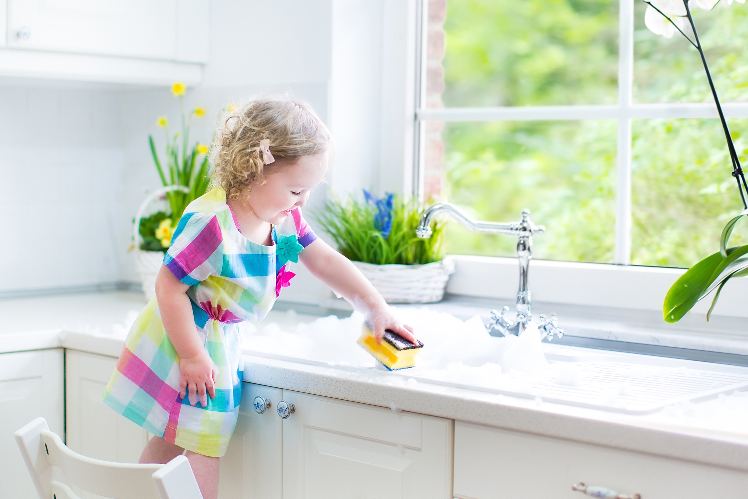girl-cleaning-near-sink